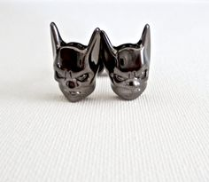 You are looking at a pair of beautiful crafted Batman emblem heavy metal gun metal cufflinks. Great gift for anyone that loves the movie. One of my favorite superheros as an adult and my favorite comi