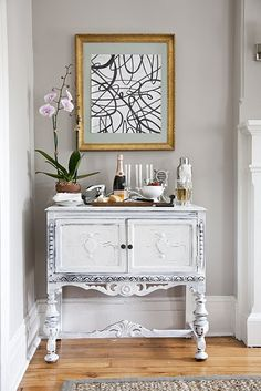 living rooms - orchid gray walls white vintage painted chest bar beveled gold leaf frame Charming small foyer with gray walls, vintage cabinet,