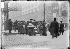 Chicago Christmas shoppers crossing an intersection on State Street in the Loop 1906