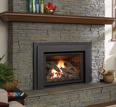 Quickly and easily replace your wood fireplace with a new gas insert. Enjoy controllable heat at the push of a button; Family Room Fireplace, Stove Fireplace, Wood Fireplace, Fireplace Design, Fireplace Ideas, Gas Fireplaces, Gas Fireplace Inserts, Pellet Fireplace Insert, Stone Mantle