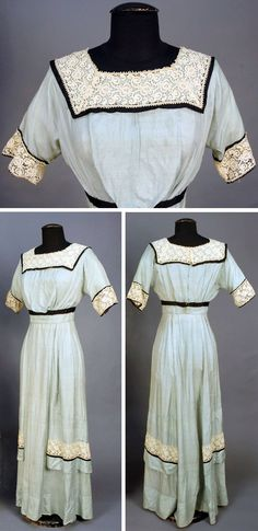 Summer dress, circa 1915. Blue slubbed silk trimmed with lace and black satin bands. Via Whitaker Auctions.