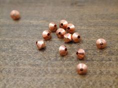 72 Solid Copper Bicone Beads 3.2 mm by blackriverbeads on Etsy
