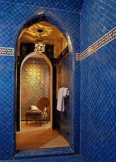 Stunning swaths of Moroccan blue zillij tile with gold come yonder.