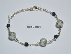 Handmade bracelet with glass beads. Grey and simple jewelry. #handmade #jewellery