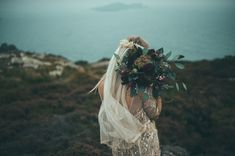 Dark and moody florals blend right into this gorgeous backdrop. | Dublin, Ireland bridal portraits via Green Wedding Shoes