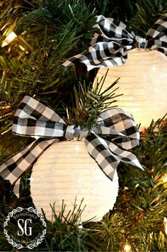this is a cute idea to tie ribbon around the top of your ornaments black christmas
