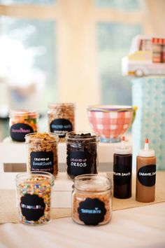 Let guests channel their inner children by setting up an ice cream station filled with sweet treats. Keep caramel, chocolate, and strawberry sauces in squeeze bottles and pour sprinkles, cookie crumbs, fruits, and candies into small glass bowls. Photo by Jenn & Dave Stark via Style Me Pretty                  Source: Other