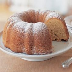 Almond Pound Cake Recipe Desserts with unsalted butter, all-purpose flour, blanched almonds, granulated sugar, eggs, vanilla extract, almond extract, baking soda, salt, sour cream, sliced almonds, confectioners sugar