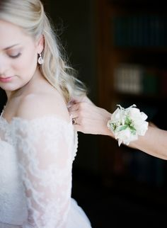 Lace long sleeve off the shoulder gown. See more here: http://www.doublegevents.com/blog/whimsical-wedding-at-waveny-house-rachel-rob