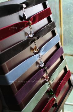 Colorful velvet ribbon choker necklaces with crystal drop pendants.