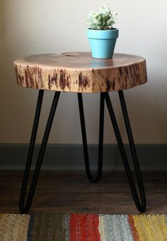 Handcrafted in India from acacia wood, this sleek side table brings a slice of nature into your space. The industrial and modern metal iron legs supports the solid finish slice of wood for an organic addition reminiscent of deep wooded forests and the great outdoors. #earthboundtrading #homedecor #furniture #modern #wood