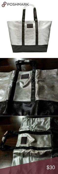 "VS Silver Metallic Weekender Tote Bag Silver Metallic Weekender Tote Bag. 16oz metallic canvas w/coated silver; 25"" L x 16"" W x 7"" H. Victoria Secret Bags Travel Bags"