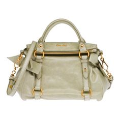 Miu Miu's shiny top handle in pistachio green with bows on the sides is simply gorgeous.
