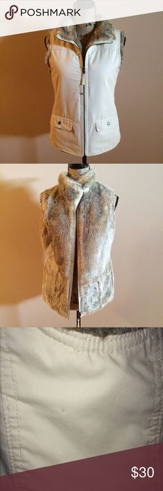 Gap reversible faux fur vest GUC, looks like 1 small pen dot under arm pit as shown in picture. Otherwise I don't see any visible markings. 2 Side pockets and 2 snap pickets Woven material: 100% cotton. Imitation fur: 78% acrylic, 22% polyester. Dry clean only. GAP Jackets & Coats Vests