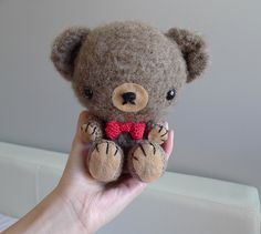 CUUUUUUUTE amigurumi crocheted teddy bear!  all instructions include pictures for each step.  when you get to the bottom of the pictures there's a link that has the pattern that you can look at <3