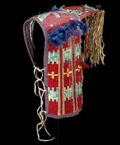 National Museum of the American Indian. Lakota model baby carrier with porcupine-quill embroidery, North or South Dakota, ca. 1880
