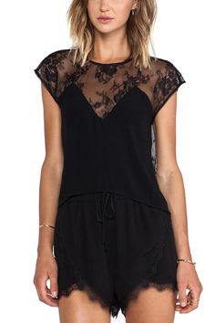 """The plunging lace back of this stunning Lovers + Friends Top adds a sultry statement to an airy silhouette. Slightly asymmetrical hem, lace panel in front, chiffon/lace blend.Pair with skinny black pants, spiky black heels, and a leather jacket for a look that is too cool for school.    XS measures: 19"""" L   Plunging Lace Top by Lovers + Friends. Clothing - Tops - Short Sleeve Clothing - Tops - Night Out Denver, Colorado"""
