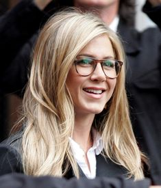 """A bespectacled Jennifer Aniston epitomise geek chic as she films her new movie 'Wanderlust"""" in West Village, New York."""