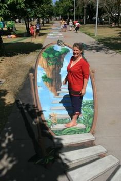 Australia's Champion Pavement Artist Jenny McCracken with her 3D Illusion 'From One Paradise to Another'