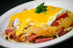 Corned Beef Hash topped with hashbrowns, eggs over easy and hollandaise sauce! Coast Restaurant, Corned Beef Hash, Hollandaise Sauce, Restaurants, Eggs, Dining, Breakfast, Food, Diners