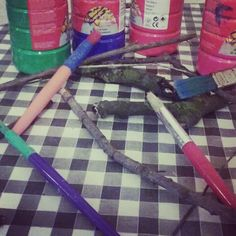 Painting sticks we collected on our walk