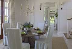 Dining room board and batten wainscoting. Dining room with full wall board and batten wainscoting, lit by Ruhlmann Single Sconces in Bronze. #Dininroom #Boardandbatten #wainscoting #wainscotting #diningroomboardandbatten #diningroomwainscotingwall #diningroomwainscotingideas Urban Grace Interiors