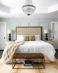 This is one bedroom we'd want to be transported to with a luxurious chandelier and tufted bedding. We share more cozy bedrooms you can glean inspiration from here in our post.
