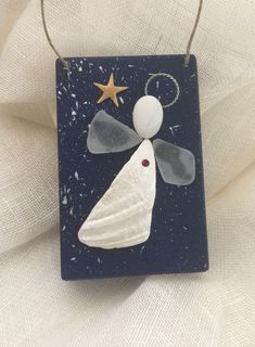 A personal favorite from my Etsy shop https://www.etsy.com/listing/574896371/beachcomber-angel-ornament