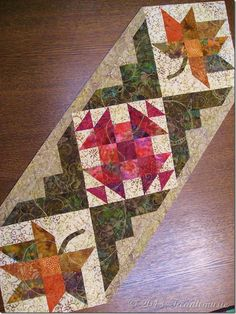 Wonderful quilting by Doreen from Treadlemusic on beautiful batik table runners… Patchwork Table Runner, Table Runner And Placemats, Table Runner Pattern, Quilted Table Runners, Small Quilt Projects, Quilting Projects, Quilting Designs, Batik Quilts, Fall Quilts