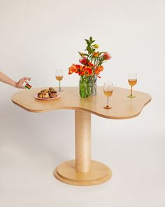 Wiggle Room launches minimalist All-Wood collection of tables inspired by Alvar Aalto's organic forms for a dose of carefree playfulness.