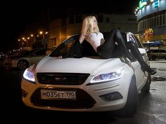 White Ford Focus mk2 facelift and Woman at night
