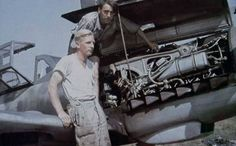2 mechanics work on a Bf-109G-6
