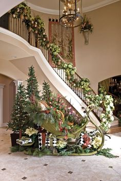 Beautiful and festive stairway and entry #Christmas #decorating