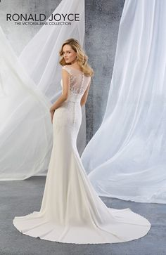 Stunning Slim fitting crepe wedding dress Stunning illusion neckline at the back Crystal detail on the belt