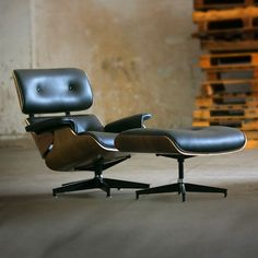 The Library Lounge Chair. Designed by Charles and Ray Eames. Modern Furniture Collection is giving away a classic Exhibition Chair! All you have to do is pin. #modernfurniture #barcelonachair #contest #pinittowinit #pintowin