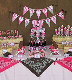 pink and brown cowgirl western themed birthday party with printables by cupcake express dessert table features hay bales bandanas and burlap