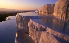 Pamukkale, a Unique Marvelous Place.    In time, due to various tectonic movements, nature has created here a fascinating view, which reveals the famous limestone bathrooms that where shaped by earthquakes, creating a real kingdom of imposing stairs. Subsequently, water covered the area between these stairs and dug in the limestone, forming small craters. The water in the area is thermal and contains hydrogen and calcium, allowing once again tourism to flourish.