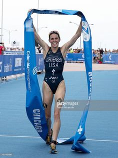 <a gi-track='captionPersonalityLinkClicked' href=/galleries/search?phrase=Gwen+Jorgensen&family=editorial&specificpeople=8022321 ng-click='$event.stopPropagation()'>Gwen Jorgensen</a> of the United States crosses the finish line and celebrates her first place win in the Elite Women's race in the 2014 ITU World Triathlon in Grant Park on June 28, 2014 in Chicago, Illinois. The event featured 130 triathletes, 60 elite paratriathletes and 4,000 age-groupers who competed along the shores of…