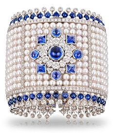 Faberge's Dentelle de Perles Bracelet. This piece is set in 18 carat white gold and features round pearls and white round diamonds and sapphires.