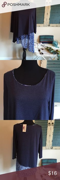 Very pretty chiffon layer boutique top This blue top has a chiffon asymmetrical trim. Very pretty boutique blouse with 3/4 sleeves. Great seasonal transition piece. Smoke free home, fast shipping, and new with tags. Like my Facebook page Looking Glass Lane Boutique. Ava james Tops Blouses