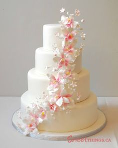 Wedding cake design will perfect your wedding concept. You can match wedding cake with your entire decoration; shape of wedding cake, color, or ornament on Orchid Wedding Cake, 4 Tier Wedding Cake, Wedding Cake Prices, Wedding Cakes With Cupcakes, Wedding Cake Decorations, Wedding Cake Designs, Wedding Cake Toppers, Wedding Flowers, Orchid Cake