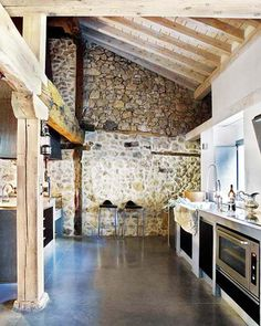Like the stained and polished cement floor, stone wall, exposed beams. . . Love the simple cement floor maybe???
