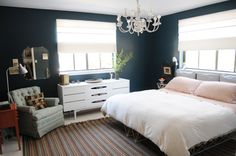 I love the deep color of the walls contrasted with the light, neutral furniture and pops of color here and there.