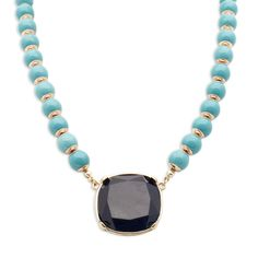 Love this! Found it on Melo & Co smooth sophistication. Polished turquoise beads give way to a large and shining deep navy stone centerpiece. Antiqued gold accents add further contrast to this alluring number. https://meloandco.kitsylane.com