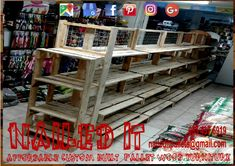 Just completed these 4 tier shelves with mesh for hanging and displaying stock. Affordable pallet wood furniture designed by you, built by us. For more info, contact 0834376919 or naileditpallets@gmail.com #palletshelves #palletshelf #palletwoodshelf #palletdisplay #palletdisplaystand #nailedpalletfurnituredurban #naileditcustombuiltpalletfurniture #nailedcustompalletfurniture #custompalletfurniture