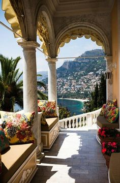 Inspiration for our front porch from this photo from The Amalfi Coast, Italy :: build cushioned seat benches between the columns ... then add some hanging flower baskets (and of course some hanging windowsill flower planters) ... perfect!