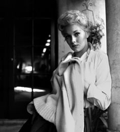 Kim Novak with sweater over shoulders  1954  © 1978 Bob Willoughby