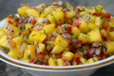 Mango Salsa  ~  This delicious colorful salsa can used as an appetizer or makes a great side or topping for meat, poultry and seafood dishes – especially during the summer for grilled dishes.    I like to blanched my onion a little to removed the strong flavor of the onions, but that depends on your taste for onions! I also would cut the amount of  jalapeños in half.