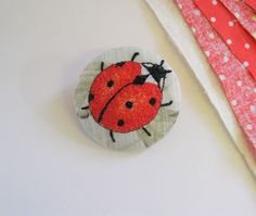 embroidered ladybird brooch, textile art, cottage chic. by AgnesandCora on Etsy https://www.etsy.com/listing/229153726/embroidered-ladybird-brooch-textile-art