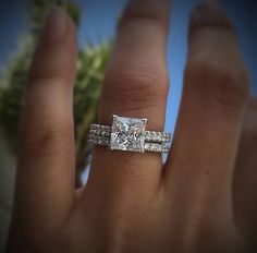 The ever popular princess cut gets the Tacori treatment with this Petite Crescent setting.